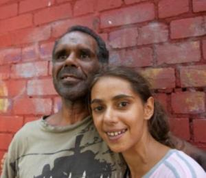 This Aboriginal Man in his forties, and adult daughter (in her twenties) were photographed using a hand-held soft-box in an outdoor location.